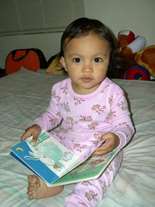 baby reading the going to bed book
