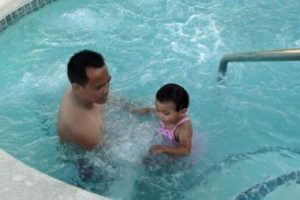 swimming father and daughter