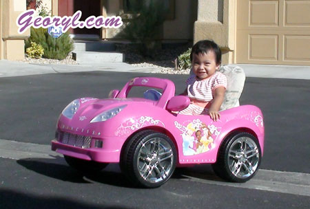 baby georyl driving pink car