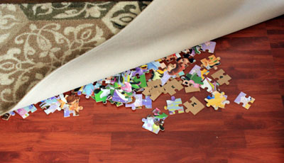 puzzle pieces underneath the carpet