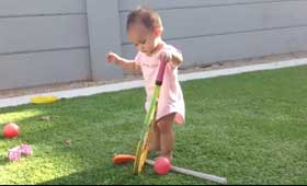 geshery baby playing tennis
